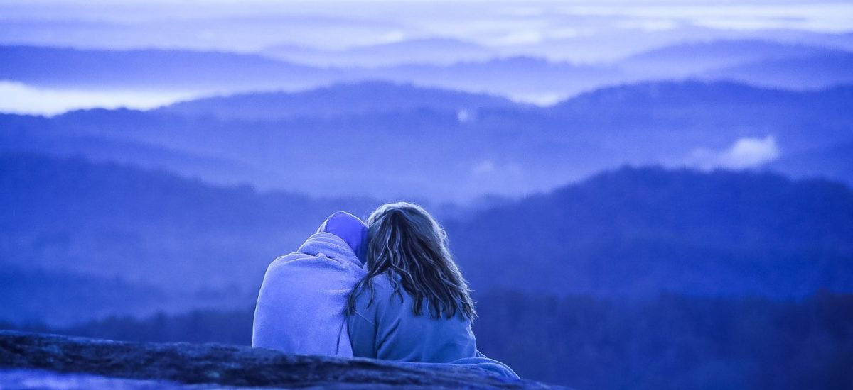 negative-space-couple-cuddles-watching-over-nature